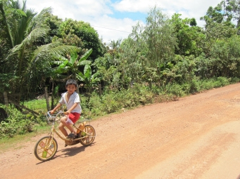 Khmer kid on a bike